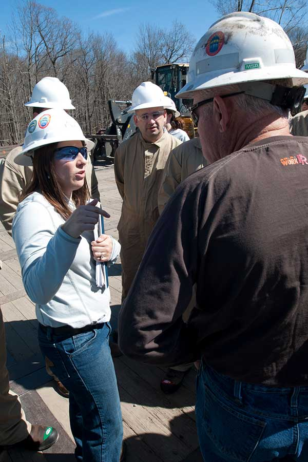 Student speaking with oil producer